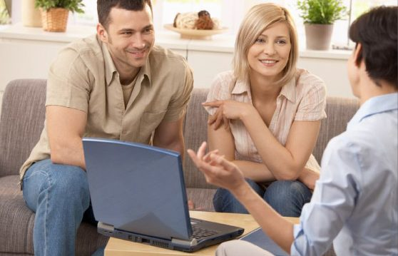 Group talking over a laptop